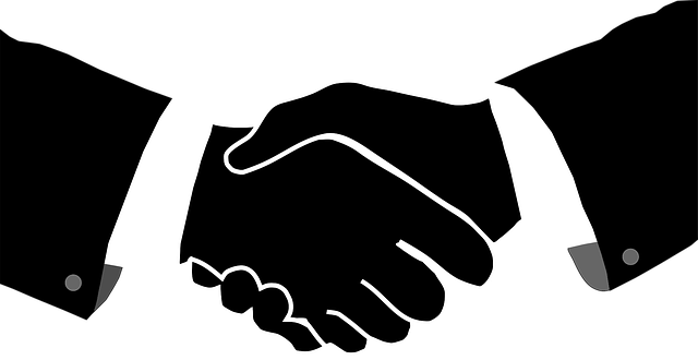 握手するモノクロのイラスト